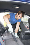 Man cleaning car with hoover. Stock Photography
