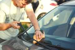 Man cleaning car with microfiber cloth. Car detailing Royalty Free Stock Images