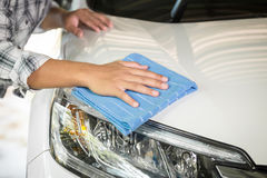 Man cleaning car with microfiber cloth Stock Photo
