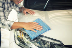 Man cleaning car with microfiber cloth. A man cleaning car with microfiber cloth, car detailing (or valeting) concept Stock Photos