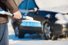 Man cleaning car from snow Royalty Free Stock Images