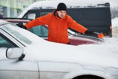 Man cleaning car from snow Stock Photography