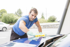Man cleaning car with sponge. Royalty Free Stock Photo