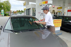 Man Cleaning the Car Windshield at a Gas Station Royalty Free Stock Photography