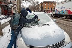 Man cleaning car windshield from ice royalty free stock photography