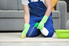 Man cleaning carpet. In living room Stock Photo
