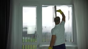 A man from a cleaning company washes Windows stock video