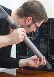 Man cleaning computer Stock Photos