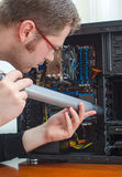 Man cleaning computer Stock Photography