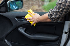 Man cleaning door in a car Royalty Free Stock Photography