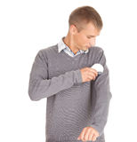 Man cleaning dust from grey sweater Stock Photography