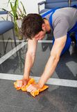 Man Cleaning With Duster Royalty Free Stock Photography
