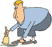 Man cleaning with a dustpan & broom Stock Image