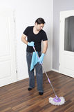 Man cleaning flat Stock Images