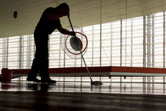 Man cleaning the floor. Man cleaning a floor in a modern building Royalty Free Stock Photography