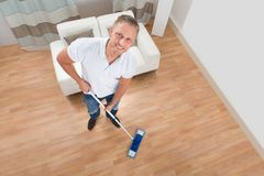 Man Cleaning Floor With Mop Royalty Free Stock Photo