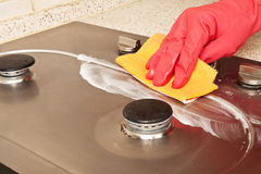 The man cleaning gas stove. With gloves Royalty Free Stock Images