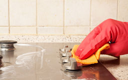 The man cleaning gas stove royalty free stock image