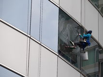 Man cleaning glass building Stock Photo