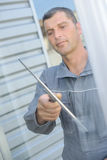 Man cleaning glass window Royalty Free Stock Images
