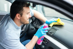 Man cleaning his car interiors Royalty Free Stock Image