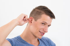Man Cleaning His Ear Royalty Free Stock Photos