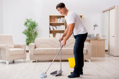 The man cleaning home with broom. Man cleaning home with broom Royalty Free Stock Photos