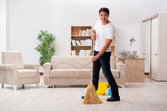 The man cleaning home with broom. Man cleaning home with broom Royalty Free Stock Photography
