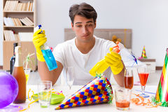 The man cleaning the house after christmas party Royalty Free Stock Photo