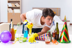The man cleaning the house after christmas party Stock Photos