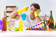 The man cleaning the house after christmas party Royalty Free Stock Photography