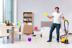 The man cleaning the house after christmas party Royalty Free Stock Images