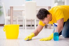 The man cleaning the house helping his wife Stock Image