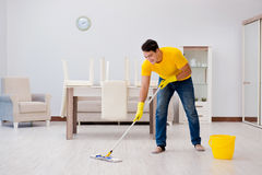The man cleaning the house helping his wife Royalty Free Stock Images
