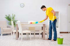 The man cleaning the house helping his wife Stock Photo