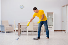 The man cleaning the house helping his wife Stock Photography