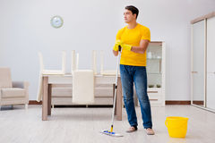 The man cleaning the house helping his wife Stock Images
