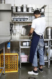Man cleaning the kitchen. In a restaurant stock images