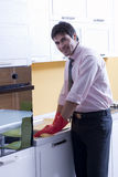 Man cleaning kitchen counter Royalty Free Stock Photo
