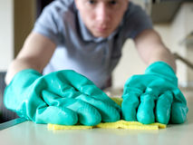 Man cleaning kitchen desk Royalty Free Stock Photo
