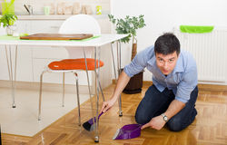 Man cleaning in kitchen Stock Photo