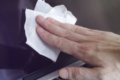 Man cleaning laptop screen Royalty Free Stock Image