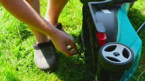 Man is cleaning lawn mower stock footage