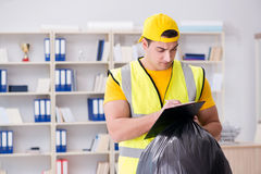The man cleaning the office and holding garbage bag Stock Photography