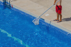 Man cleaning the pool Royalty Free Stock Image