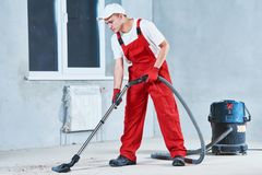 Cleaning service. dust removal with vacuum cleaner stock photos