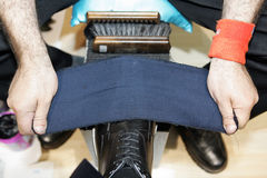 Man cleaning shoes Stock Photo