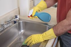 Man cleaning the sink Stock Image