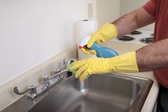 Man cleaning the sink Stock Photo