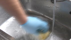 Man cleaning sink stock video